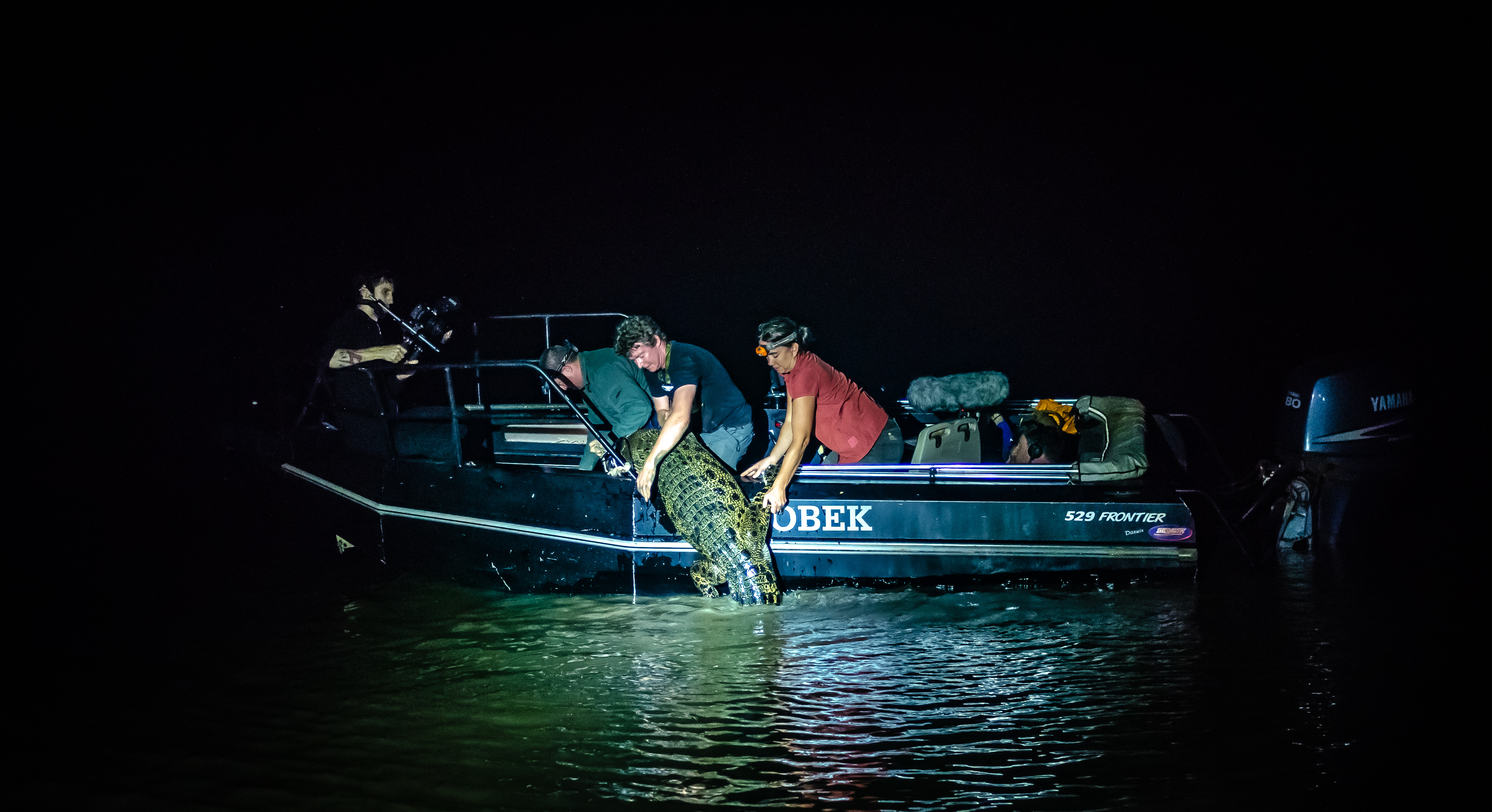 Working with zoologist Adam Britton to catch a crocodile